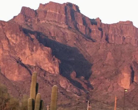Cougar shadow on Superstition Mts
